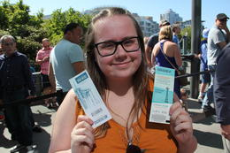 Paige with our tickets to the Space Needle , John G - July 2017