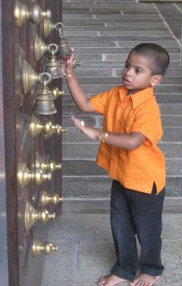 A small boy captured our attention, ringing the bells on the temple door - September 2009