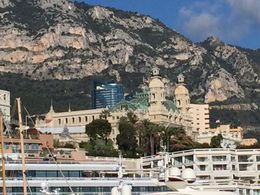 Monaco ... Monte Carlo Casino as seen from water zoomed in, so not the best quality and behind it with the blue glass exterior is probably the most expensive to buy apartment block in Europe! , Bev Chislett - January 2016