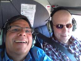 We were in the back row on the outbound flight and won the coin flip for a front seat return. Both were equally picturesque with commentary throughout. , Paul A - March 2014