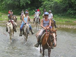 the small group riding through a river , anita p - August 2016