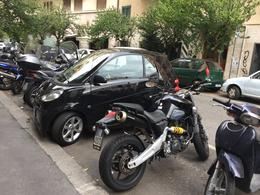 The streets of Rome - where parking spaces are wisely used and shared. , Vickie S - November 2017