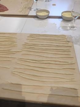 Dough rolled out in to the shape of pici pasta before cooking it. , laura.senzamici - September 2016