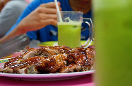 Roasted duck with a plate of rice and a cool drink - July 2012