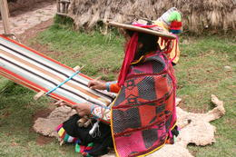 local woman weaving dyed alpaca yarn , John L - November 2014
