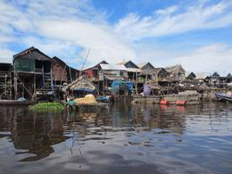 Row of houses on stilts, in Kampong Phluk on Tonle Sap Lake , Shirls - October 2014