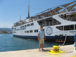 Docked in Poros with Brian and our ship in background. , Gerhard - August 2017