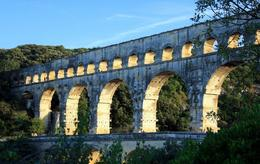 The Pont du Gard in the reflection of the setting sun., Helen L - September 2010