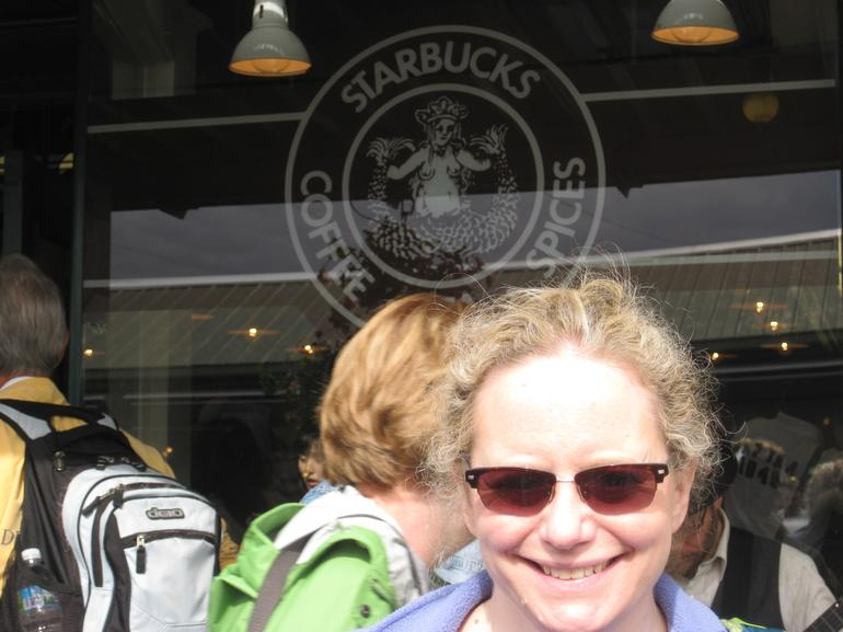 Me in front of the Starbucks logo - Seattle
