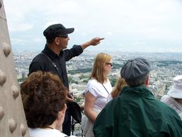 Our guide shows us the view of Paris from the Eiffel Tower - July 2009