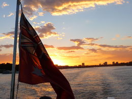 The sun sets off the stern of the boat during the cruise into Sydney Harbor. , Janelle E - April 2015