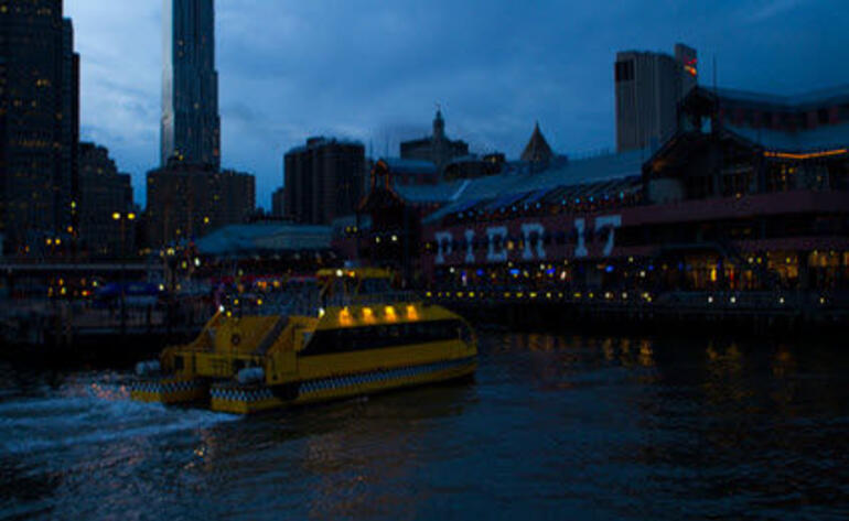 Water Taxi arriving at South Street Seaport - New York City