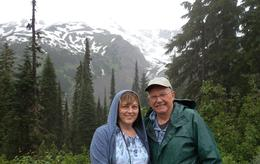 Frank and Terry Calovini in front of Mount Rainier. Rainy weather...but did't spoil the view. The tour was wonderful. Beautiful wildlife. , terrylou - September 2014