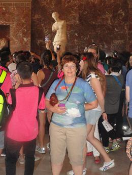 Here I am posing in front of the famous Venus statue at the Louvre. This photo shows the large crowds in August which the tour helps you navigate your way around. , Martha W - August 2013