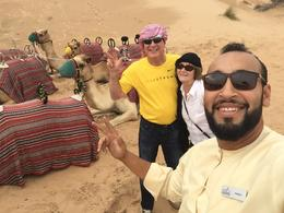 Getting ready for the camel ride with our tour guide. , Steven H - December 2017