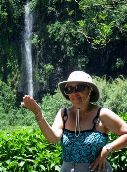 Bonnie standing before one of the many waterfalls in the interior of the island , Stuart N - December 2013