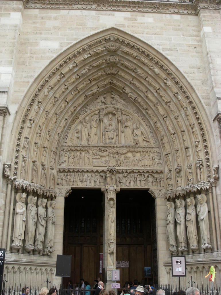 Entry way to inside Notre Dame - Paris