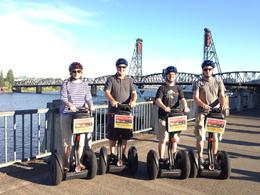 Lori, Steve, Dan and Will Eldrenkamp posing on Segways. , Stephen E - August 2014