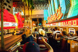 The Las Vegas Big Bus driving by Binion's Casino at the Fremont Street Experience during the optional night tour., Viator Insider - December 2017