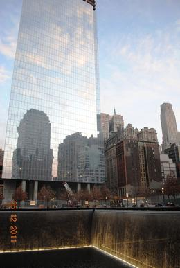 the waterfall where one of the towers stood and the building of the new world trade centre in the background , Foodtroll - January 2012