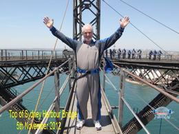 Not the most flattering picture but they insist (quite rightly) that the belt is very tight and the suit is very big. Probably the scariest part of the climb as the path between the two arches is..., Norman H - December 2012