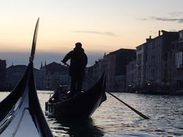 We were lucky to be on the Grand Canal at sunset .. and to on be the second gondola rather than the first, so that I could snap this gondolier in the evening light. , kmaria1202 - January 2016