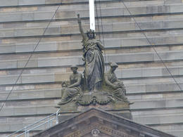 The guide pointed out to us the miniature Statue of Liberty on top of the City Chambers building. , Amy - June 2013