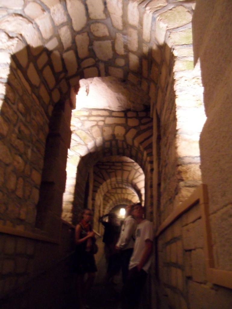 Underground arches at the Catacombs in Paris - Paris