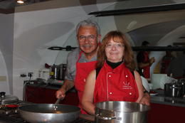 Ed and Gale posing for a picture at the stove making Tomato Sauce out of fresh tomatoes. , Edward Banda Jr - October 2014