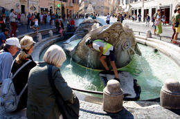 Our guide showed us how to get a drink from the fountain by stepping onto the large rock. , Ron - October 2013