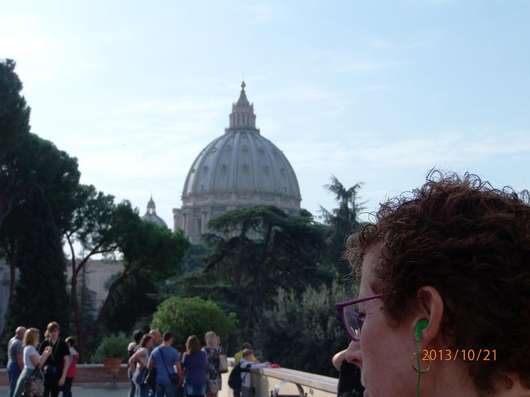 Inside the Vatican with St. Peter's basilica in the background. - Rome