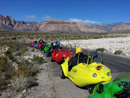 Twelve scoot cars were following each other during our trip. This was at one of three stops we made. , Jim - April 2014