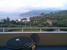 Overlooking the beautiful water and scenery from the balcony of the Hotel Universo , Teresa M - May 2016