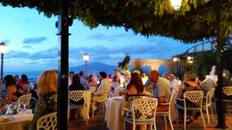 This was dinner on the cliffs of Sorrento with Mt. Vesuvius in the background! Just beautiful and included in the upgrade price! Well worth it! , Frank D - September 2014