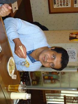 Enjoying the famous Okonomiyaki. , Maxy J - May 2013