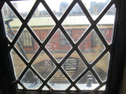The infamous traitors gate through the window of one of the towers , LeaAnne E - April 2012