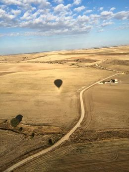 View of Segovia from the balloon. I love the shadow of our balloon against the beautiful backdrop of Segovia's farmlands , JESSICA.DEVERSON - October 2015