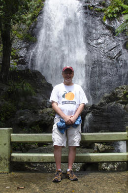 Tom posing by the roadside waterfall which was our first photo opp on the tour. , Thomas G - September 2014