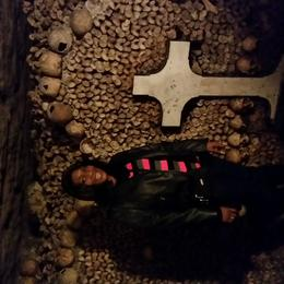 Me... standing by one of the ossuaries in the catacombs. This was a really nice experience. , LisaMarie - November 2014