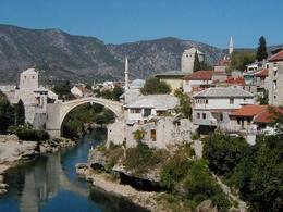 A view from the next bridge towards the famous old bridge was was damaged and rebuilt after the 90's war in Mostar. - October 2007