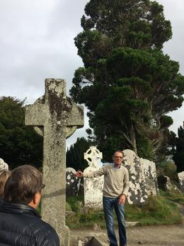 Tour guide at Cemetery near ruins of St Kevin's Kitchen , Kathy - November 2017