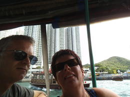 David and Julie having fun viewing the floating village, Loved it - Thanks Hong Kong , D W S - December 2014