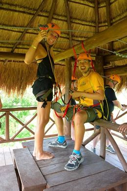 Our tour guide Benny getting me locked and loaded for zip lining. , Michelle M - June 2016