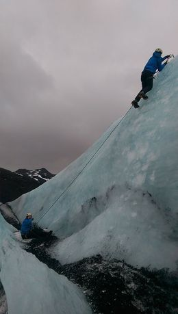 My attempt to scale the ice with our guide Snorri belaying (no he's not sitting down, his foot had just sunk a bit deeper into the snow!) , Matthew B - February 2015