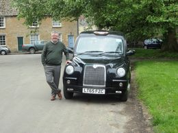 This is Steve and his black cab in the town of Bampton Downton Village , John P - June 2016