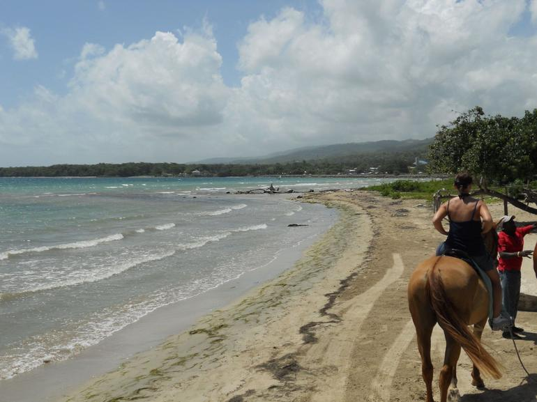 Horseback riding on the beach, Ocho Rios, Jamaica - Jamaica