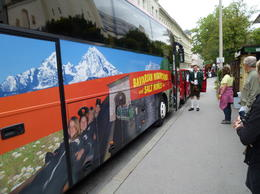 Side photo of tour bus and guide before departure , D A P - August 2013