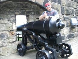 I (James) standing next to one of the ancient cannons that once defended the castle in Edinburgh Scotland! , James R - June 2013