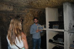 The wine guide takes us into the underground cellars of Magnan La Gaffeliere. , Timothy C - September 2014