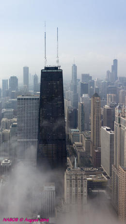Hancock Tower peaking out of the Lake Michigan fog at 100 stories and 1,127 feet. , N Robert A - August 2014
